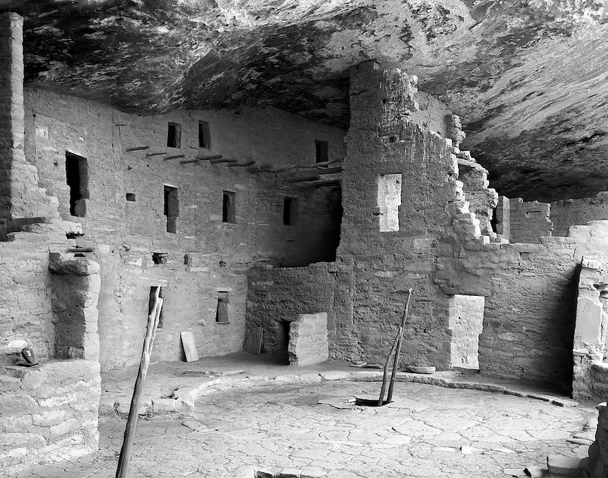 """""""Spruce Tree House""""<br /> Mesa Verde National Park<br /> 2015<br /> <br /> Spruce Tree House is the third largest cliff dwelling in Mesa Verde.  Constructed in the 13th century by the ancient Puebloans, the structure contains 130 rooms and 8 kivas or ceremonial chambers.  It is believed to be the residence for 60-80 people.  Spruce Tree House has suffered little deterioration because a large natural overhang protects it. Overlooks from above offer superb views. <br /> <br /> 4 x 5 Large Format Film"""