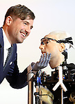 """World's first bionic man at Science museum today.5.2.13.Bertold Meyer - who has a bionic hand himself - with the robot """"Rex"""".as TV crews look on.Face of Rex was modelled on Bertold....Pic by Gavin Rodgers/Pixel 8000 Ltd"""