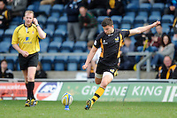 Tommy Bell of London Wasps is watched by referee Wayne Barnes as he takes a conversion attempt during the Aviva Premiership match between London Wasps and Exeter Chiefs at Adams Park on Sunday 21st April 2013 (Photo by Rob Munro)