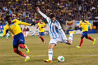 Argentina midfielder Ricardo Alvarez (16) shoots as Ecuador defender Frickson Erazo (3) defends. Argentina and Ecuador played to a 0-0 tie during an international friendly at MetLife Stadium in East Rutherford, NJ, on November 15, 2013.