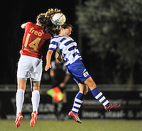20130906 - OOSTAKKER , BELGIUM : Gent's Evy De Smedt pictured in a headerduel with PSV 's Mirte Roelvink (left) during the female soccer match between AA Gent Ladies  and PSV / FC Eindhoven Dames , of the third matchday in the BENELEAGUE competition. Friday 06 th September 2013. PHOTO DAVID CATRY