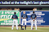 West Michigan Whitecaps outfielders Rashad Brown (25), Cam Gibson (23) and Jose Azocar (27) stand during the national anthem before the Midwest League game against the Dayton Dragons on April 24, 2016 at Fifth Third Ballpark in Comstock, Michigan. Dayton defeated West Michigan 4-3. (Andrew Woolley/Four Seam Images)