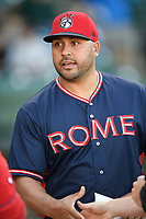 Manager Matt Tuiasosopo (27) of the Rome Braves meets with the umpires before a game against the Greenville Drive on Friday, April 19, 2019, at Fluor Field at the West End in Greenville, South Carolina. Greenville won, 2-0. (Tom Priddy/Four Seam Images)