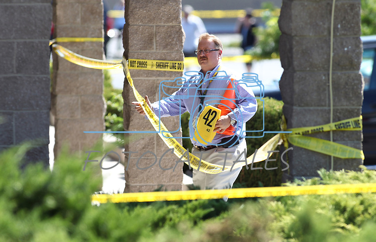 Carson City Sheriff's officials investigate the scene of a shooting in an IHOP restaurant in Carson City, Nev., on Tuesday, Sept. 6, 2011. (AP Photo/Cathleen Allison)