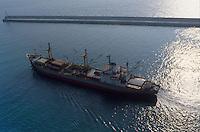- cargo ship leave the port of Genoa....- nave da carico esce dal porto di Genova