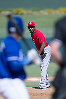 Cincinnati Reds pitcher Wendolyn Bautista looks to his catcher for the sign during an Instructional League game against the Kansas City Royals on October 2, 2017 at Surprise Stadium in Surprise, Arizona. (Zachary Lucy/Four Seam Images)