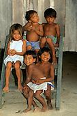 Ariau, Amazon, Brazil. Children sitting on wooden steps.
