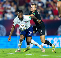 NASHVILLE, TN - SEPTEMBER 5: Jordan Pefok #19 of the United States is defended by Alistair Johnston #2 of Canada during a game between Canada and USMNT at Nissan Stadium on September 5, 2021 in Nashville, Tennessee.