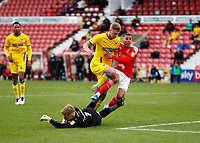 10th October 2020; The County Ground, Swindon, Wiltshire, England; English Football League One; Swindon Town versus AFC Wimbledon; Daniel Csoka of AFC Wimbledon challenges Tyler Smith of Swindon Town in the final moments of the injury time in the 2nd half in the penalty box while Goalkeeper Connal Trueman of AFC Wimbledon dives for the ball