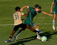 Saint Louis Athletica defender Kendall Fletcher (24) and FC Gold Pride midfielder Formiga (31) during a WPS match at Anheuser-Busch Soccer Park, in St. Louis, MO, July 26, 2009.  The match ended in a 1-1 tie.