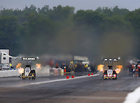 Aug 17, 2014; Brainerd, MN, USA; NHRA top fuel dragster driver Tony Schumacher (left) races alongside Doug Kalitta during the Lucas Oil Nationals at Brainerd International Raceway. Mandatory Credit: Mark J. Rebilas-