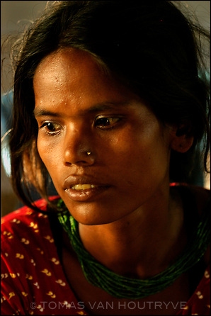 """Burmi Sunar, who belongs to a dalit of """"untouchable"""" caste waits for treatment for her baby in hospital in Nepalgunj, Nepal on 15 June, 2004. Nepal has perhaps the most traditional remaining caste society on earth.<br />"""