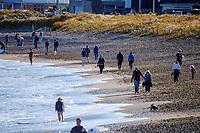 People walk along Lyall Bay in Wellington, New Zealand on Saturday, 11 September 2021. Photo: Dave Lintott / lintottphoto.co.nz