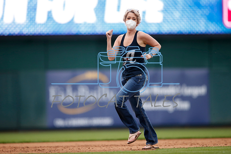 """Amanda Petch, a cervical cancer survivor, runs the bases as part of the Saint Mary's """"Home Run for Life"""" event at the Reno Aces game against the Tacoma Rainiers, in Reno, Nev., on Friday, May 28, 2021. <br /> Photo by Cathleen Allison"""