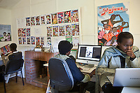Staff and artists at the offices of Shujaaz FM creating the next issue of the comic.