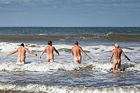 Pictured: Four men brave the freezing cold sea to skinny dip in Dunraven Bay, Wales, UK.<br /> Re: A Summer Solstice skinny dip swim, organised by local naturist group, the Nudie Dudies, has taken place in Dunraven Bay in south Wales, UK.<br /> Those taking part are encouraged to raise money for a charity close to their own hearts at the same time.