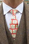The Tweed Run London UK. Man wearing tweed and tie with bicycle motifs design.