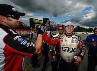 Sept 9, 2012; Clermont, IN, USA: NHRA funny car driver Mike Neff celebrates with a crew member after winning the US Nationals at Lucas Oil Raceway. Mandatory Credit: Mark J. Rebilas-