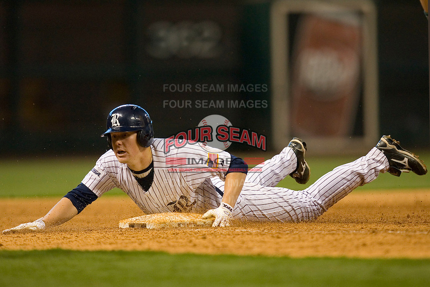 Steven Sultzbaugh #21 of the Rice Owls slides into third base with a triple versus the Baylor Bears in the 2009 Houston College Classic at Minute Maid Park March 1, 2009 in Houston, TX.  The Owls defeated the Bears 8-3. (Photo by Brian Westerholt / Four Seam Images)