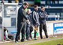 Hibs' manager Alan Stubbs throws away his tea during the second half.