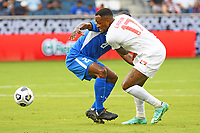 KANSASCITY, KS - JULY 11: Cyle Larin #17 of Canada tries to get past Sebastien Cretinoir #21 of Martinique during a game between Canada and Martinique at Children's Mercy Park on July 11, 2021 in KansasCity, Kansas.