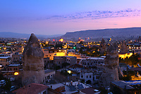 Panorama of Goreme village at sunrise with hot air balloons, Cappadocia
