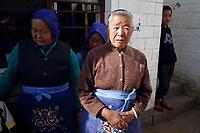 CHINA. Women of the Samatao minority in Zijun village in Kunming. 2010