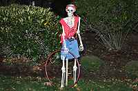 Life-sized skeletons are dressed up for Halloween decorations along Hillcrest Road in Belmont, Massachusetts, USA, on Mon., Oct. 30, 2017. A resident said the neighborhood has been doing similar coordinated decorations along the road for the previous 3 or 4 years. In this image, the skeleton is holding a hula hoop.