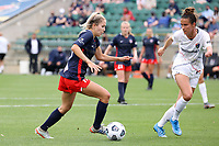 CARY, NC - APRIL 10: Ashley Sanchez #10 of the Washington Spirit is defended by Carson Pickett #4 of the North Carolina Courage during a game between Washington Spirit and North Carolina Courage at Sahlen's Stadium at WakeMed Soccer Park on April 10, 2021 in Cary, North Carolina.