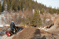 Ryan Redington on a near-snowless section of the trail 13 miles after leaving the Rohn checkpoint during Iditarod 2009