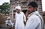 66-year-old Manganiyar artist, Lakha Khan speaks to local villagers outside his house in Raneri village of Jodhpur district in Rajasthan, India. Photo: Sanjit Das/Panos