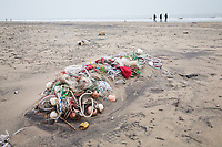Discarded fishing equipment lie on an oil-stained beach at Laomi Gukou in Hebei province. Bohai Bay is home to some of China's largest reserves of oil and gas, making it a centre for oil exploration. The region has suffered from a number of oil spills in recent decades which continue to effect local ecosystems. 2019