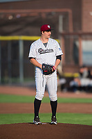 Idaho Falls Chukars starting pitcher Jon Heasley (51) prepares to deliver a pitch during a Pioneer League game against the Great Falls Voyagers at Melaleuca Field on August 18, 2018 in Idaho Falls, Idaho. The Idaho Falls Chukars defeated the Great Falls Voyagers by a score of 6-5. (Zachary Lucy/Four Seam Images)