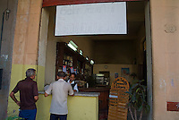 People buying food and drink at a local cafe_ on Prado Avenue, Havana, Cuba.