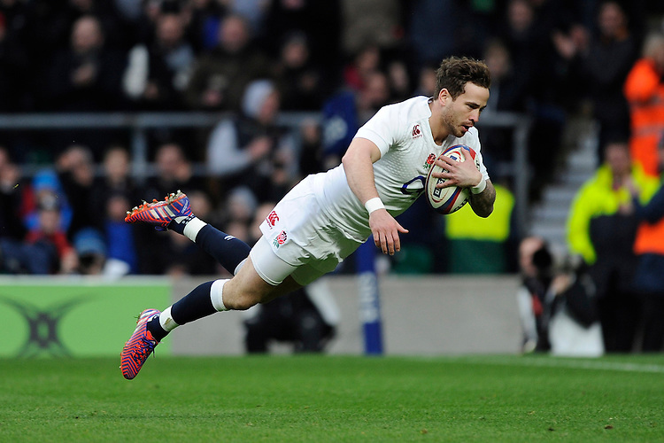 Danny Cipriani of England dives dramatically to score a try moments after coming onto the pitch as a substitute during the RBS 6 Nations match between England and Italy at Twickenham Stadium on Saturday 14th February 2015 (Photo by Rob Munro)