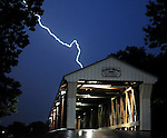 A lightning display lights up the covered bridge at Eldean Road near Troy, Ohio.