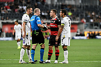 30th December 2020; Bankwest Stadium, Parramatta, New South Wales, Australia; A League Football, Western Sydney Wanderers versus Macarthur FC; Simon Cox of Western Sydney Wanderers discusses the over turning of the penalty decision with referee Kurt Ams