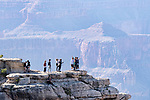 Tourists gawk outsiide the safety rails at Grand Canyon National Park, Arizona, USA.  Near Desert View viewpoint.