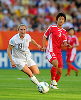 Rachel Buehler (l) of Team USA and Ho Un Byoi of Team North Korea during the FIFA Women's World Cup at the FIFA Stadium in Dresden, Germany on June 28th, 2011.