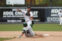 West Michigan Michigan Whitecaps second baseman Anthony Pereira (9) turns a double play as Fort Wayne TinCaps baserunner Webster Rivas (8) arrives at second base during the Midwest League baseball game on April 26, 2017 at Fifth Third Ballpark in Comstock Park, Michigan. West Michigan defeated Fort Wayne 8-2. (Andrew Woolley/Four Seam Images via AP Images)