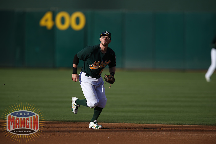 OAKLAND, CA - MAY 18:  Eric Sogard #28 of the Oakland Athletics makes a play at second base during the game against the Kansas City Royals at O.co Coliseum on Saturday May 18, 2013 in Oakland, California. Photo by Brad Mangin