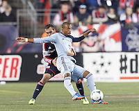 Tightly defended Sporting Kansas City forward Teal Bunbury (9) passes the ball. New England Revolution defender A.J. Soares (5). In the first game of two-game aggregate total goals Major League Soccer (MLS) Eastern Conference Semifinal series, New England Revolution (dark blue) vs Sporting Kansas City (light blue), 2-1, at Gillette Stadium on November 2, 2013.