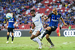 Chelsea Forward Michy Batshuayi (L) fights for the ball with FC Internazionale Defender Joao Miranda (R) during the International Champions Cup 2017 match between FC Internazionale and Chelsea FC on July 29, 2017 in Singapore. Photo by Marcio Rodrigo Machado / Power Sport Images