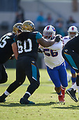 Buffalo Bills Ryan Davis (56) rushes against A.J. Cann (60) during an NFL Wild-Card football game against the Jacksonville Jaguars, Sunday, January 7, 2018, in Jacksonville, Fla.  (Mike Janes Photography)