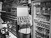 """Bartoszyce 15.12.2019 Poland<br /> A saleswoman in a neighbourhood store in Bartoszyce presents the most popular volume of alcohol - """"Lufka"""" plastic glasses with a capacity of 40ml"""" for 1.99zl<br /> Photo: Adam Lach<br /> <br /> Sprzedawczyni w sklepie osiedlowym w Bartoszycach prezentuje najpopularniejsza pojemnosc alkoholu - """"Lufka"""" plastikowe kieliszki o pojemnosci 40ml"""" za 1.99zl<br /> Photo: Adam Lach"""