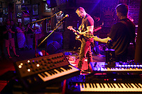Jim Goza (center) performs with his band The Juice, Saturday, July 17, 2021 at George's Majestic Lounge in Fayetteville. Check out nwaonline.com/210718Daily/ for today's photo gallery. <br /> (NWA Democrat-Gazette/Charlie Kaijo)