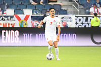 KANSASCITY, KS - JULY 11: Stephen Eustaquio #7 of Canada with the ball during a game between Canada and Martinique at Children's Mercy Park on July 11, 2021 in KansasCity, Kansas.