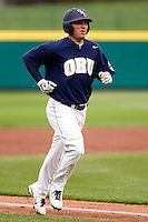 Brandon King (25) of the Oral Roberts Golden Eagles heads down the line toward home plate after hitting a home run during a game against the Missouri State Bears on March 27, 2011 at Hammons Field in Springfield, Missouri.  Photo By David Welker/Four Seam Images