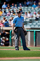 Umpire Nate Tomlinson handles the calls behind the plate during a game between the Salt Lake Bees and the Fresno Grizzlies at Smith's Ballpark on September 3, 2018 in Salt Lake City, Utah. The Grizzlies defeated the Bees 7-6. (Stephen Smith/Four Seam Images)