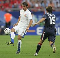 Zdenek Grygera (2) of the Czech Republic is defended by USA's Bobby Convey (15). The Czech Republic defeated the USA 3-0 in their FIFA World Cup Group E match at FIFA World Cup Stadium, Gelsenkirchen, Germany, June 12, 2006.